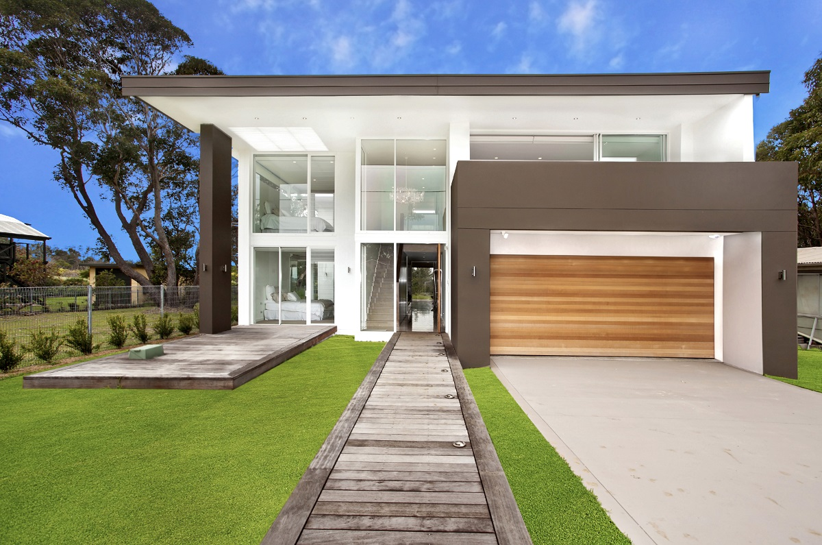 10B-shutterstock_88083229- luxury home frontage against blue sky