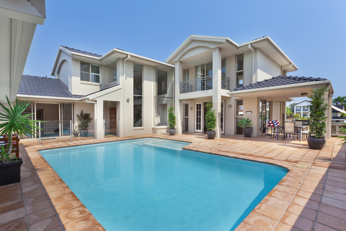13-shutterstock_172533392- luxurious backyard with pool in modern australian mansion