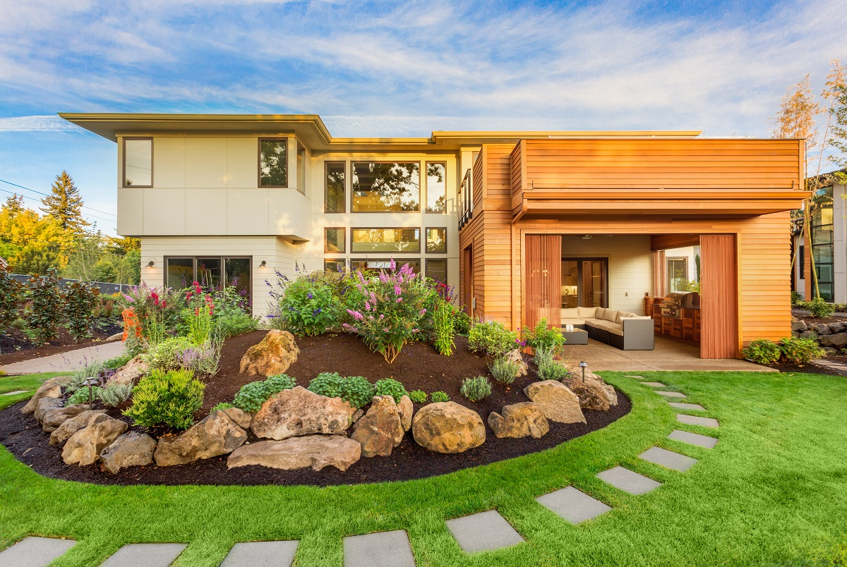 7-shutterstock_360087803- Beautiful Luxury Home Exterior with Balcony and Green Grass on Sunny afternoon