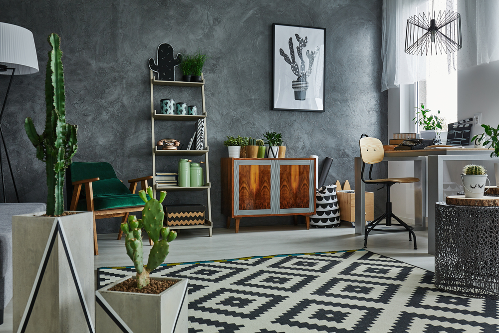 grey apartment with decorative cactus carpet and wooden furniture