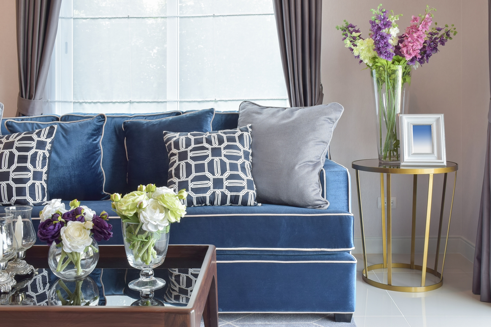 navy blue modern classic sofa set with beautiful flower vases in nice living corner