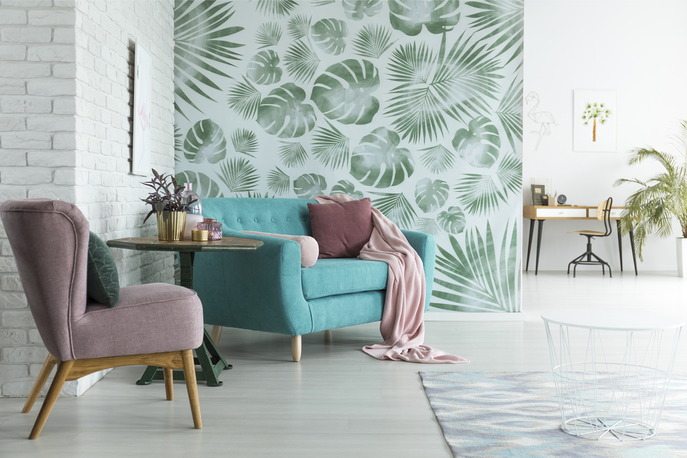 bright flat with white brick wall and monstera leaves wallpaper in botanic living room
