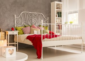 Use sleek furniture in small bedroom