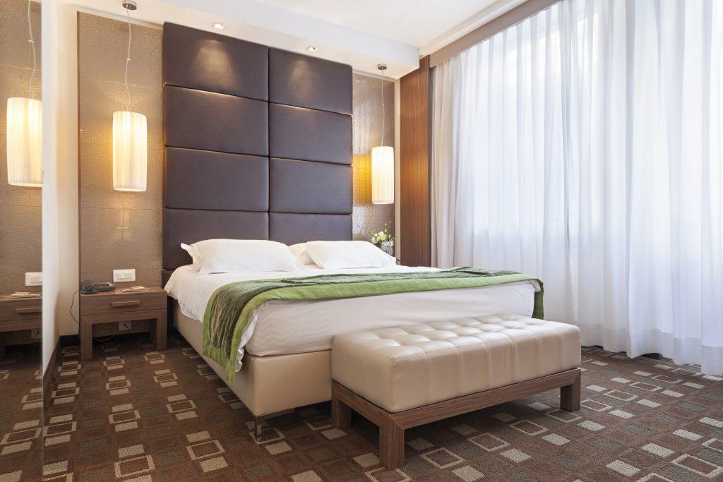 Decor Essentials For The Master Bedroom - A creative headboard